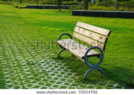 Park bench  in sunset. - stock photo