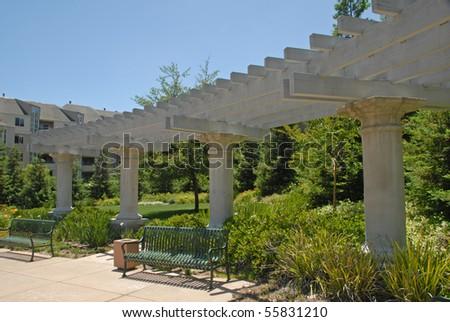 Park Garden Sitting Area With Large Column Arbor