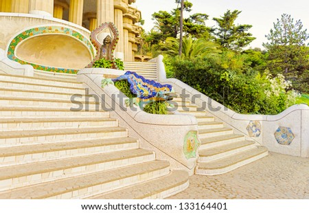 Park Guell entrance with the ceramic dragon fountain designed by Antoni Gaudi, Barcelona, Spain. - stock photo
