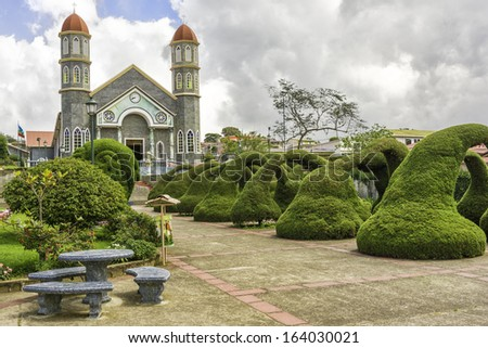 Park in front of the Catholic Church in Zarcero Costa Rica. - stock photo