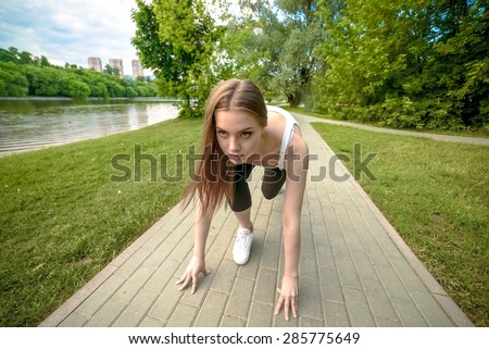 Park jogging. Nice girl is running in Serebryaniy Bor in Moscow - stock photo