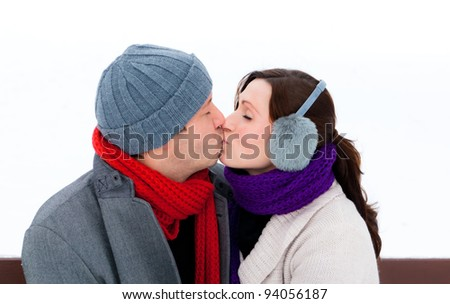 park sitting kissing people - stock photo