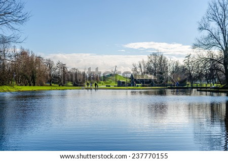 Park with a pond in the fall - stock photo