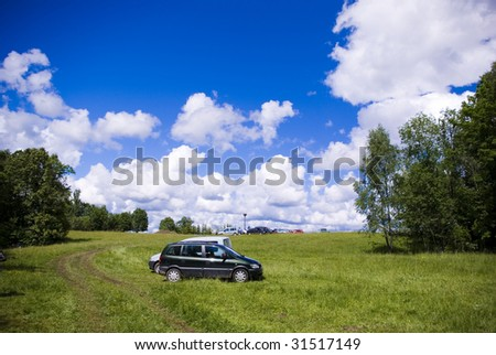 park with auto on the grass - stock photo
