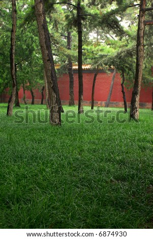 Park with Red Wall - stock photo