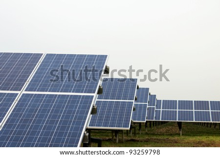 Park with solar cells in front of a overcast sky - stock photo