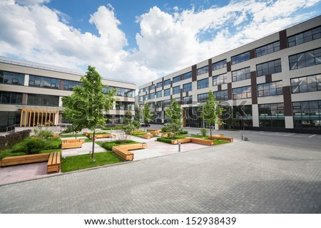 Park with trees and fountains in front of the Business Center - stock photo