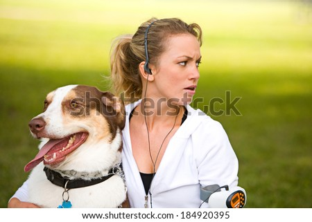 Park: Woman Surprised By Noise In Park - stock photo