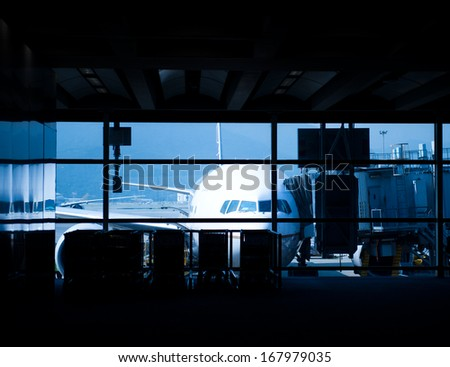Parked aircraft on hong kong airport through the gate window. - stock photo