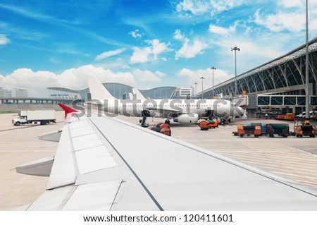 Parked aircraft on shanghai airport - stock photo