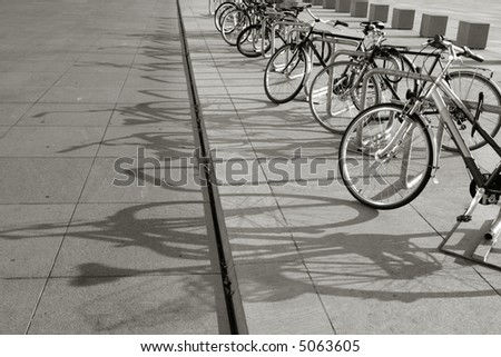 Parked bicycles on the sidewalk - stock photo