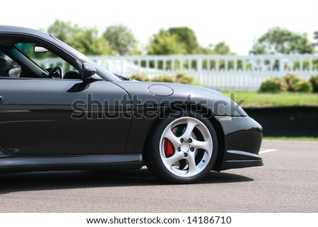 Parked black Porsche 911 Turbo sports coupe car - stock photo