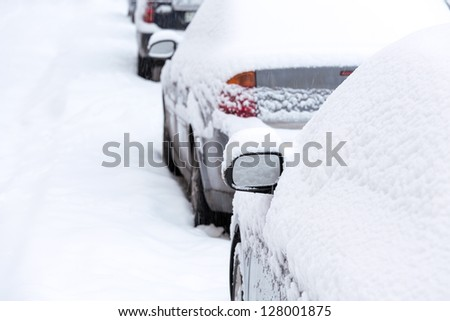 Parked cars covered with snow - stock photo