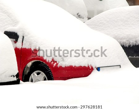 Parked cars covered with snow during snowstorm - stock photo