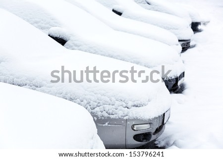 Parked cars in winter - stock photo