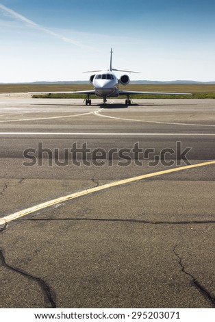 parked private jet on the runway. white civic, modern airplane - stock photo