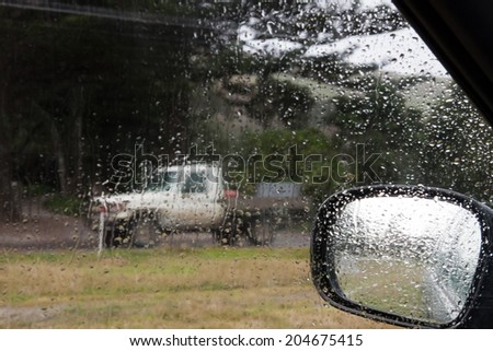 parked up at the beach on a wet day  - stock photo
