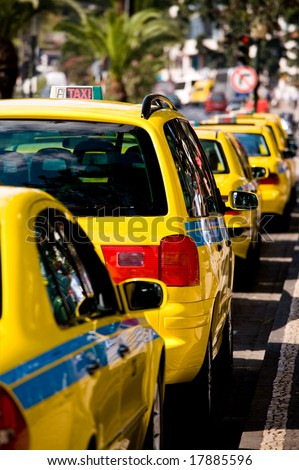Parked Yellow Taxi Cab Waiting for a Fare in Funchal City, Madeira Island, Portugal - stock photo