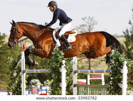 PARKER, CO - JULY 18: Successful Canadian rider Karen Cudmore wins second place riding Ulano in the $50,000 Grand Prix of Denver at the Colorado Horse Park on July 18, 2009 in Parker, CO. - stock photo