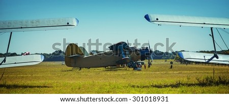 Parking biplanes - stock photo