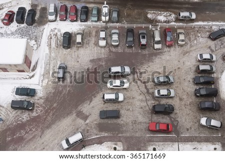Parking car near the apartment building in winter, view from above - stock photo