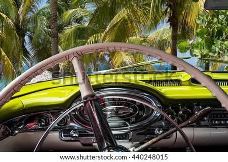 Parking colorful vintage cars near the beach in Varadero Cuba - stock photo