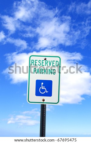 Parking for disabled or wheelchair space, on blue sky
