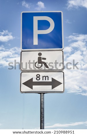 Parking for disabled, Two signs for a handicap parking area  - stock photo