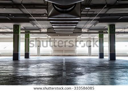 Parking garag interior, industrial building,Empty underground parking background - stock photo