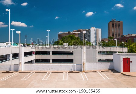 Parking garage and highrises in Towson, Maryland. - stock photo