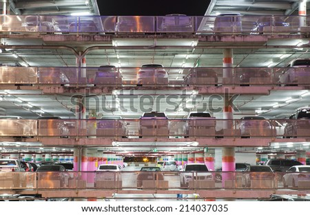 Parking garage at night - stock photo