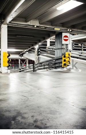 Parking garage in basement, underground interior. Neon light in bright industrial building. - stock photo