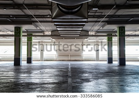 Parking garage interior, industrial building - stock photo