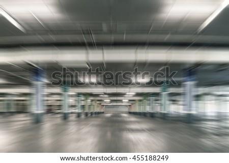 Parking garage, interior parked cars.Motion blur - stock photo