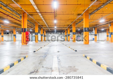 Parking garage parked cars - stock photo