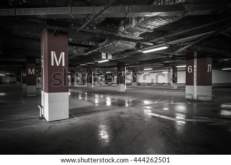 Parking garage underground interior - stock photo