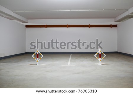 Parking garage, underground interior without cars - stock photo