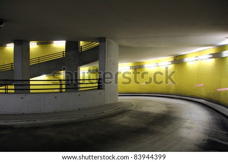parking garage with bright neon lights at night - stock photo