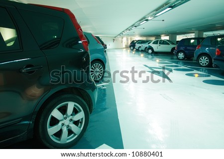 Parking in the parking garage in cyan tone - stock photo