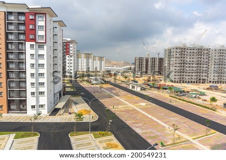 Parking lot at apartment during construction stage - stock photo