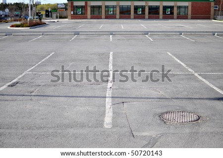 Parking lot in a commercial plaza - stock photo