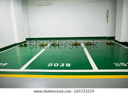 Parking lot in an underground garage - stock photo