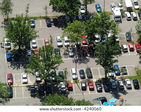 parking lot under trees - stock photo