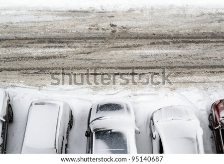parking lot with cars covered in snow detail view from above - stock photo
