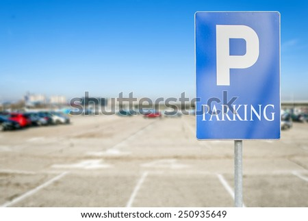 Parking lot with number of authorized parking sign  - stock photo