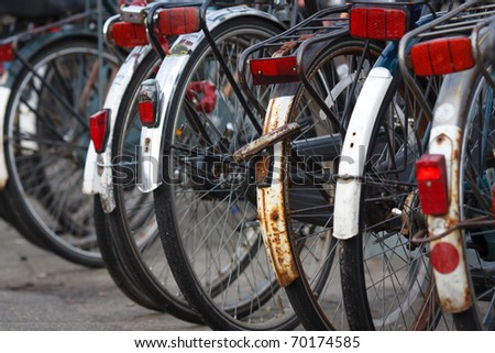 Parking of old bicycles in Amsterdam,closeup,shallow focus - stock photo