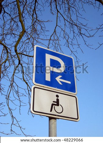 parking on the left hand for disabled person - stock photo