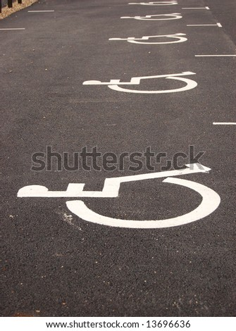 Parking place for handicapped. Sign painted on asphalt
