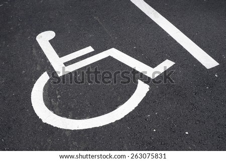 Parking place reserved for disabled people. - stock photo