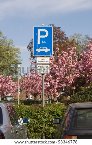 Parking Sign in Germany With Parking Ticket Monday-Friday 9am-6pm; Saturday 9am-1pm - stock photo